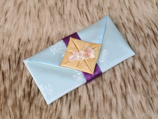 Furoshiki themed Korean money wallet in mint. This is an aesthetic color that's favored by both men and women. It is used to gift money and letters to an extended family member or close friend during weddings and other special Korean celebrations and traditions.