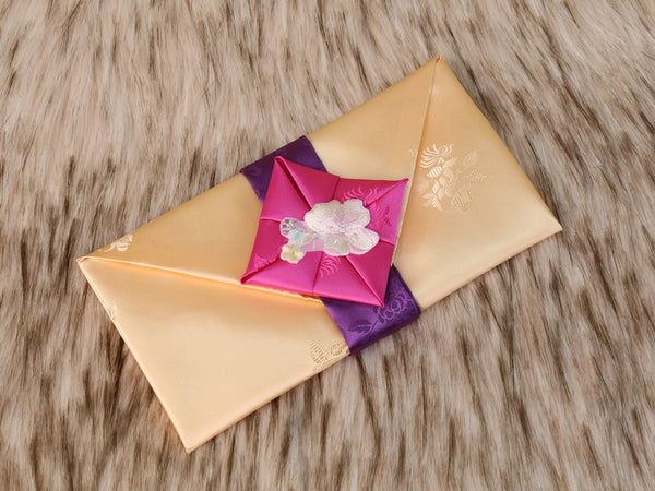 Furoshiki themed Korean money wallet in yellow. This colorful envelope has a beautiful floral embroidery and is also made with a silk fabric that's furoshiki themed.