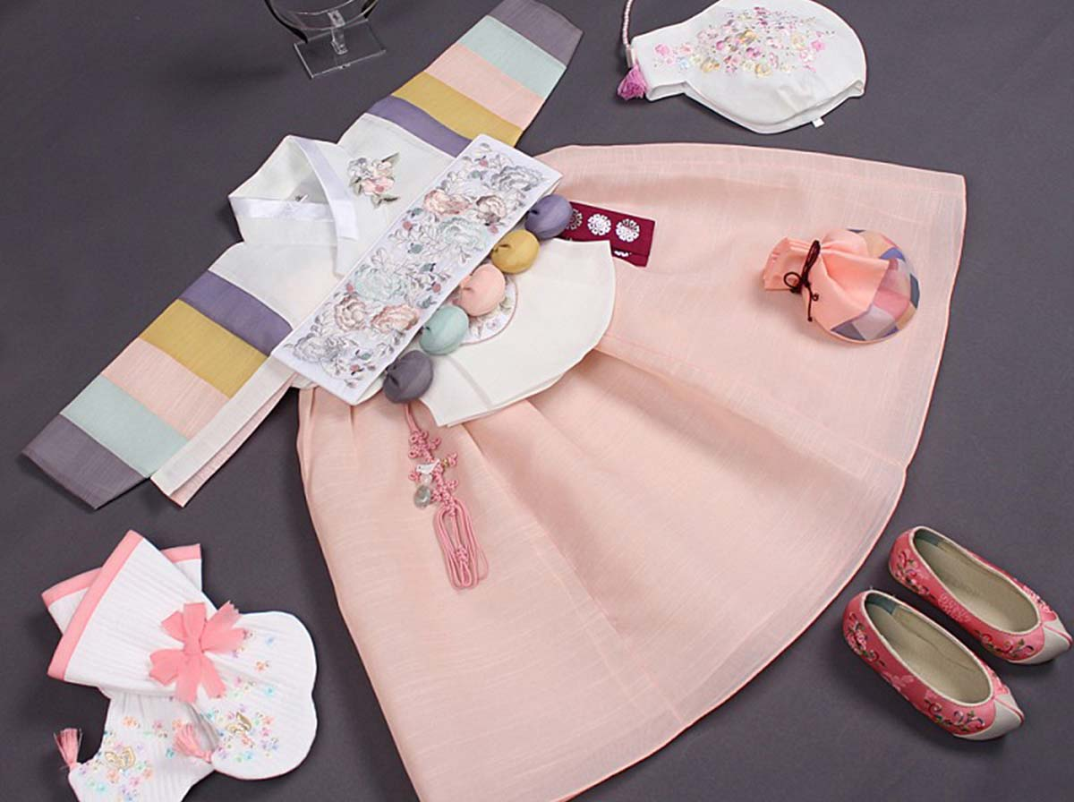 Our baby girl hanbok in light pink and cream long version comes in 100 day, 1 year, and 2 year old styles.