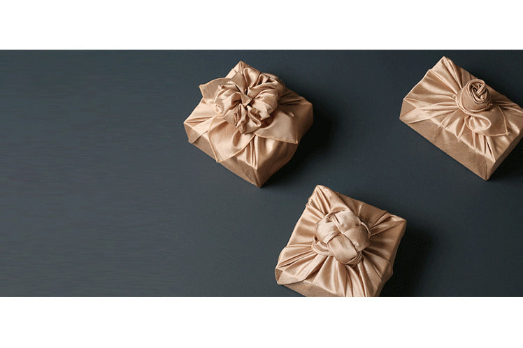 The sand colored Bojagi art makes a prime reusable gift wrap choice for anniversaries.