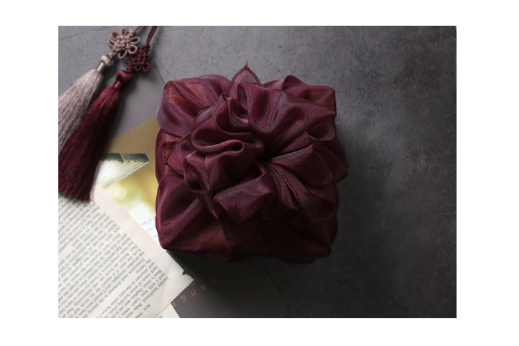 Make the fabric gift wrap even cooler by tying a cute bow at the top to create Bojagi art.