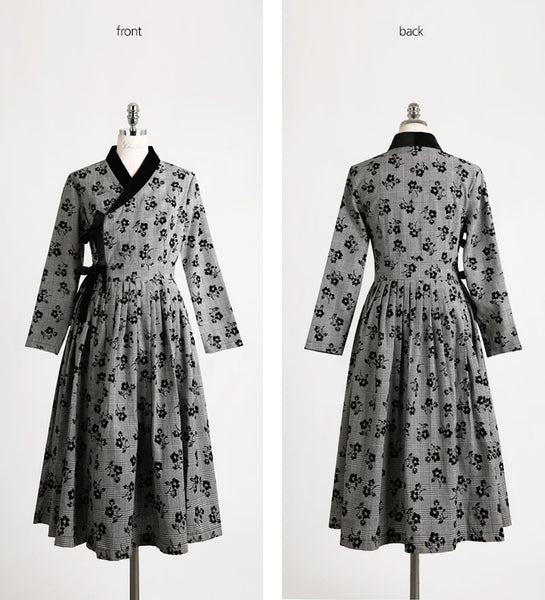 There are elements of the traditional Korean hanbok found within this modernized hanbok dress in slate gray and midnight black.