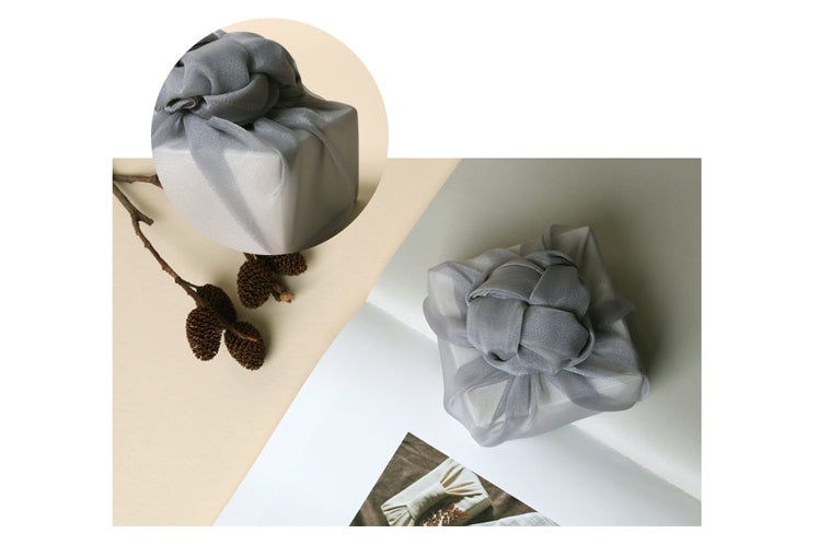 Decorative bows and knots in stone color add even more beauty if you're wrapping presents with fabric.