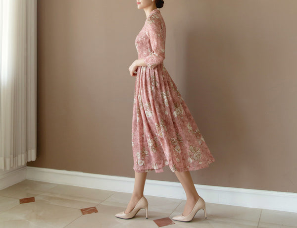 A more feminine modern hanbok in light pink floral print adds a touch of vibrant color to your everyday look.
