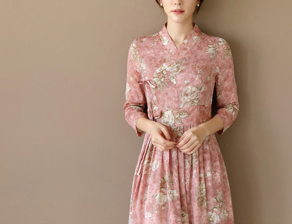 You'll look and feel absolutely gorgeous wearing this blush colored flower modern hanbok dress.