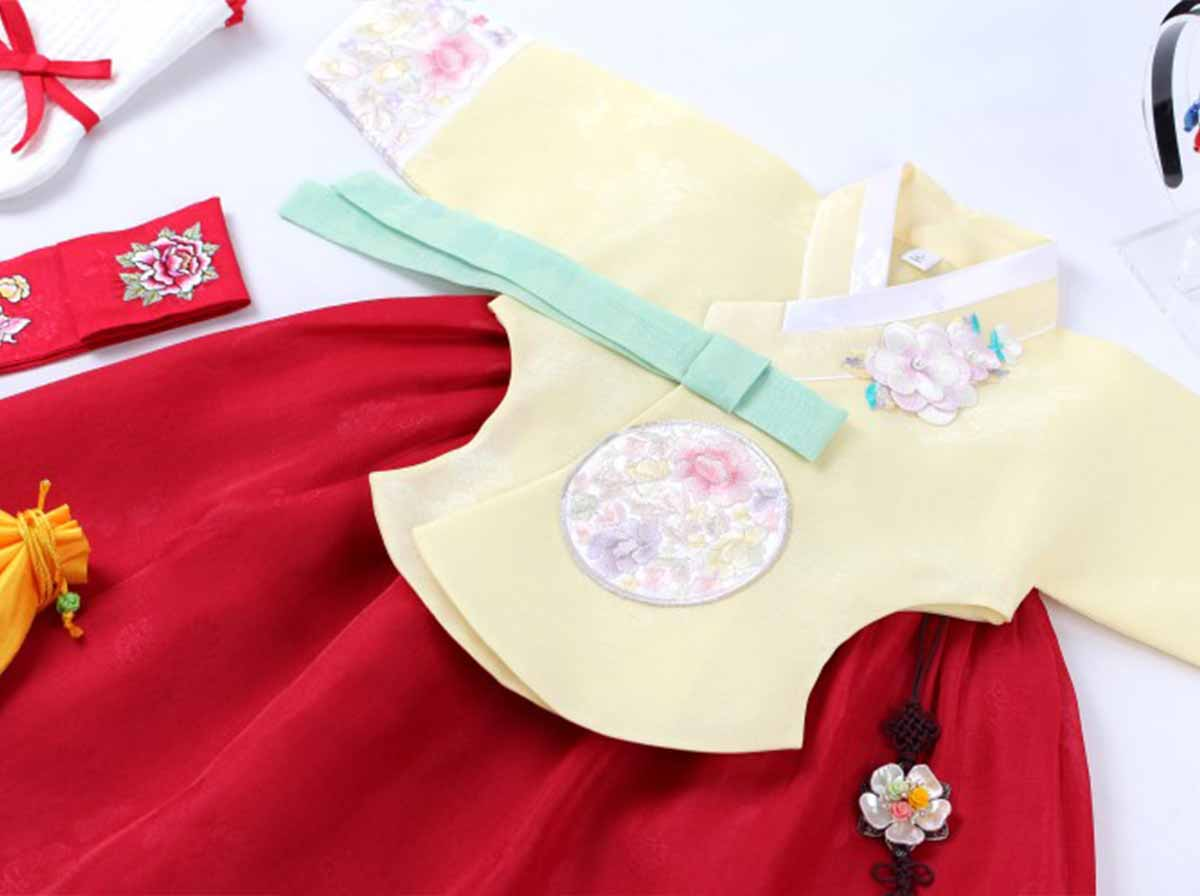 The baby girl hanbok in ruby and gold really is stunning and makes your baby girl look majestic.
