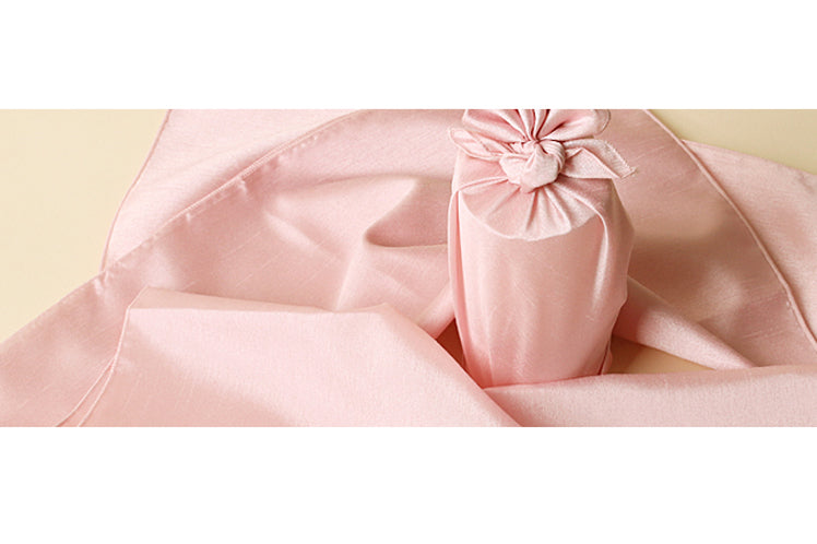 The coral single sided Korean Bojagi is an exquisite fabric wrapping cloth for a baby shower.