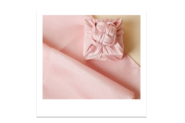 A rouge Korean wrapping cloth looks outstanding on any table or as a decorative item for knick-knacks.