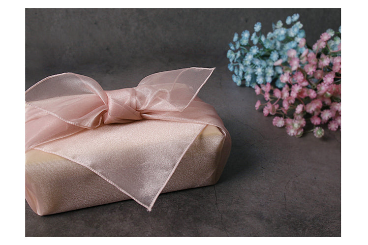 A pretty bow on top makes this fuchsia Korean Bojagi fabric wrapping perfect for a little girl or even grown woman.