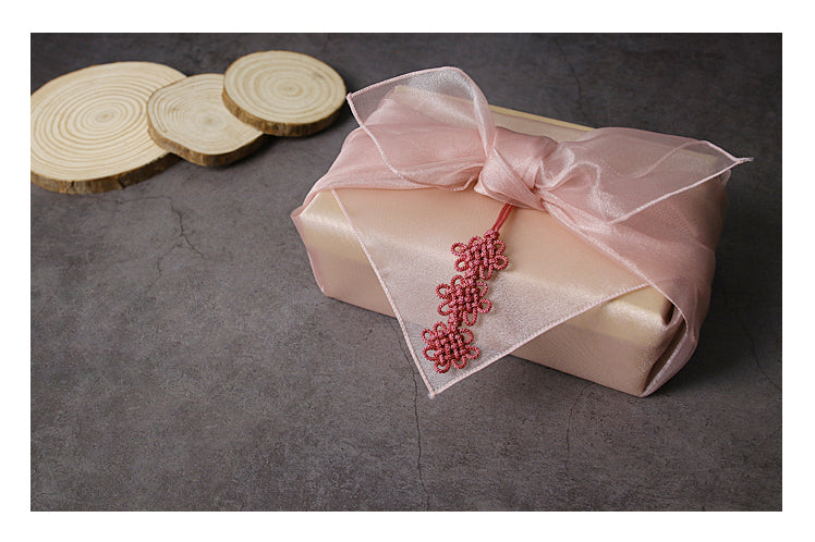 Add a flower or other decoration to the blush lucid Bojagi for sale to have a picture-book finish to the wrapping cloth.