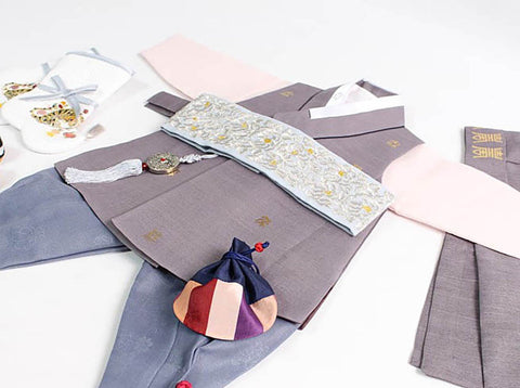 The baby boy hanbok in dark gray is not only visually very appealing, but it also is traditionally Korean.