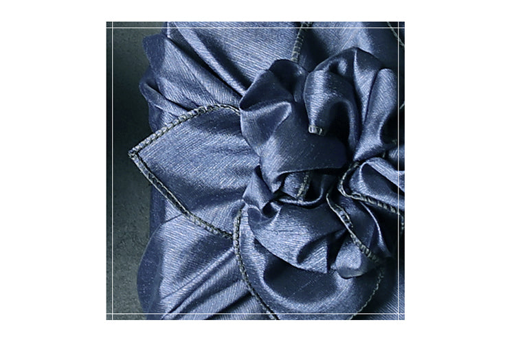 Delicate knots at the top of the cyan single sided Bojagi gift wrapping cloth are classy and dramatic.