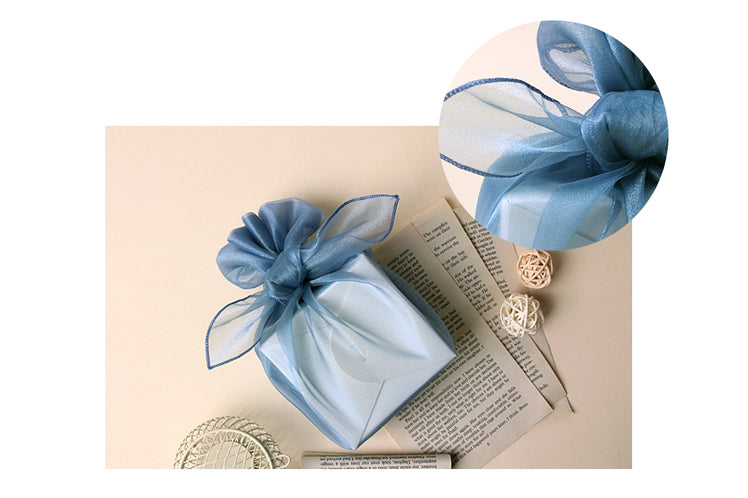 Fabric wrapping paper has so many uses and in turquoise it can be used to wrap any present for boys and girls.