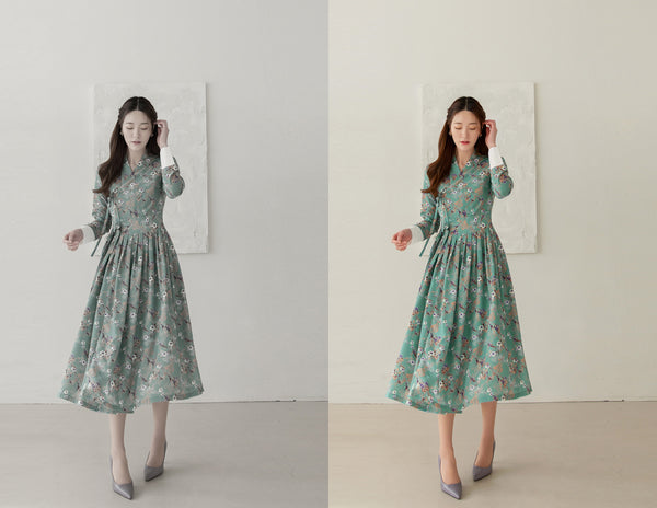 A greenish-blue flower modern hanbok dress is perfect for spring and summer and brings a hint of Korean culture to your everyday wardrobe.
