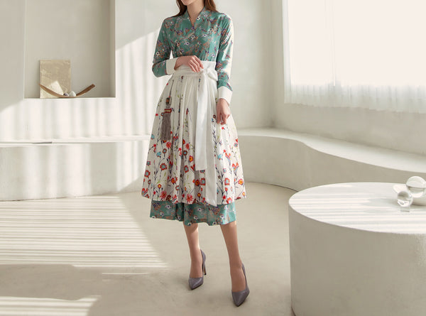 A blossoming flower is full of life and energy, which is how you'll feel wearing this light green flower modern hanbok dress.