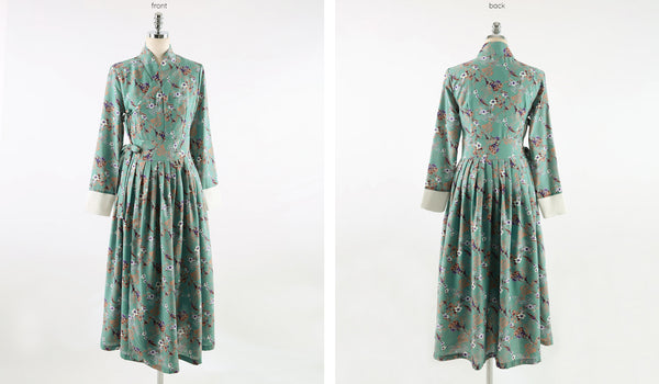 You can really see the pastel and flower elements with this complete shot of the greenish-blue flower modern hanbok dress.