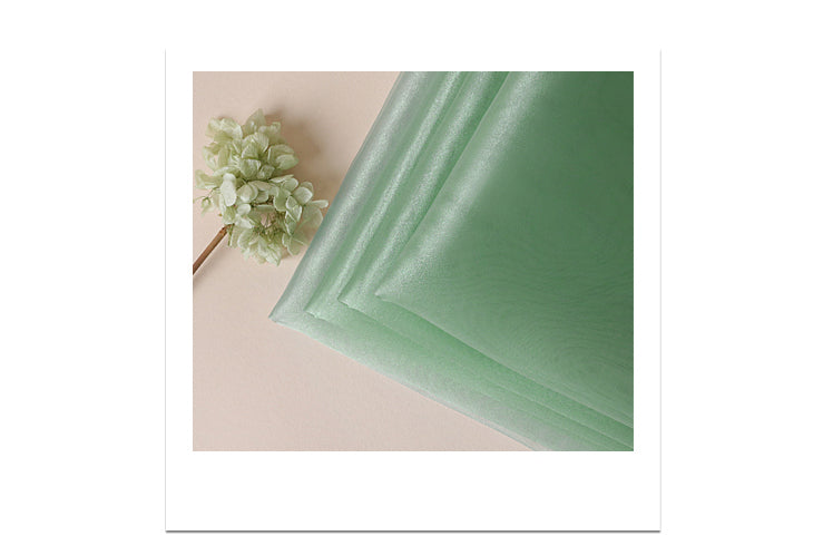 The thin material makes this teal colored Bojagi Korean gift wrap perfect for delicate gifts.