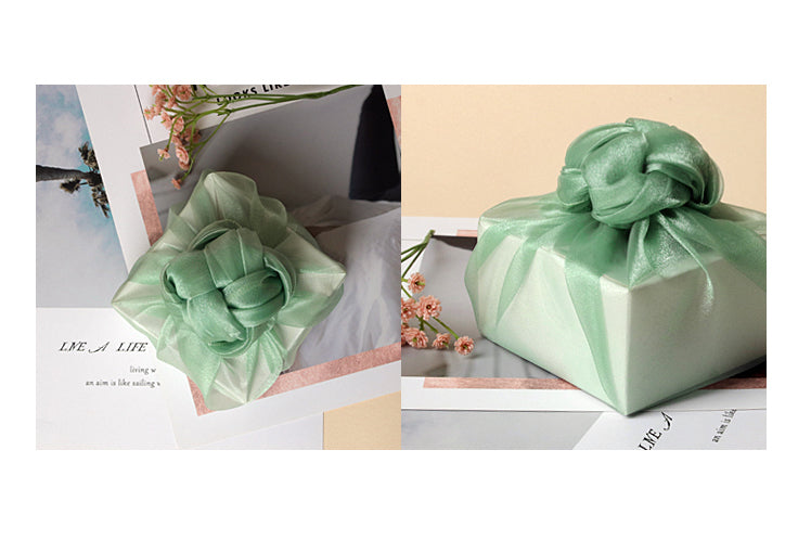 Fancy bows on top of this aqua lucid Korean wrapping cloth Bojagi look chic and it's perfect for men and women.