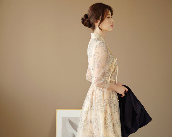 This is a beautiful modern hanbok in beige that is used for weddings.