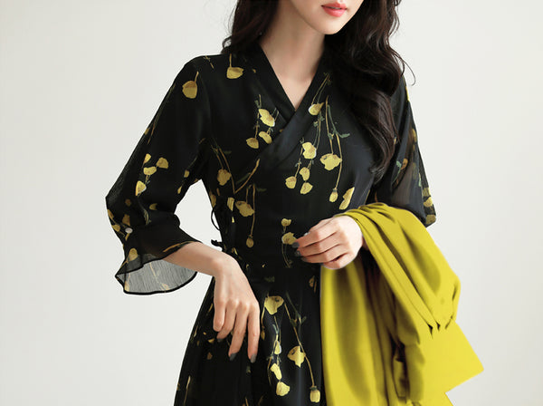 Add an element of Korean tradition with this raven and amber modern hanbok dress in flower print.