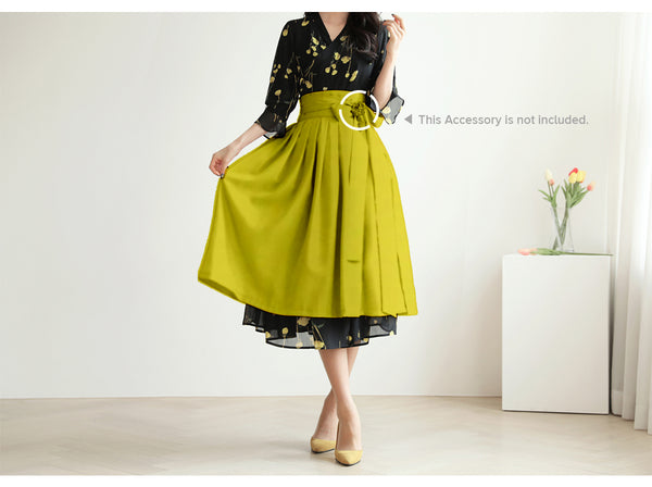 The flowers on this midnight and golden modern hanbok dress make it an ideal outfit for spring and summer.
