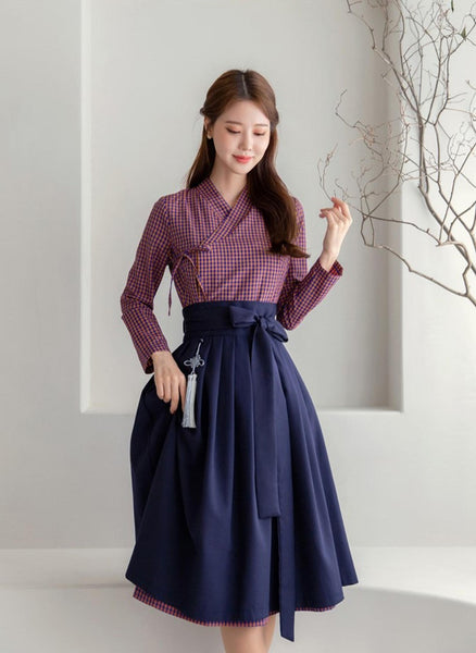 This is a modern hanbok skirt in navy. This is often paired with a lighter type of modern hanbok dress for women. We provide quality skirts whether they are for casual or modern events. Use them for weddings or even casual night out with your friends!