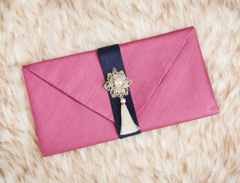 Tassel & Ornament Korean Wedding Money Envelope in Plum Red that's often used by Korean women to gift their friend money or a special letter.