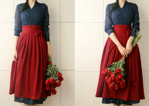 The sea blue modern hanbok dress can be worn with traditional Korean clothing or with a pair of jeans.