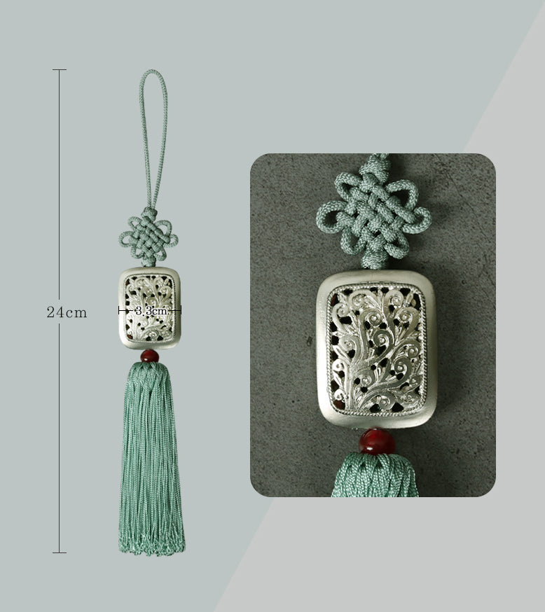 The detail on this square tassel is seen in this up close image and the dimensions are shown as well.