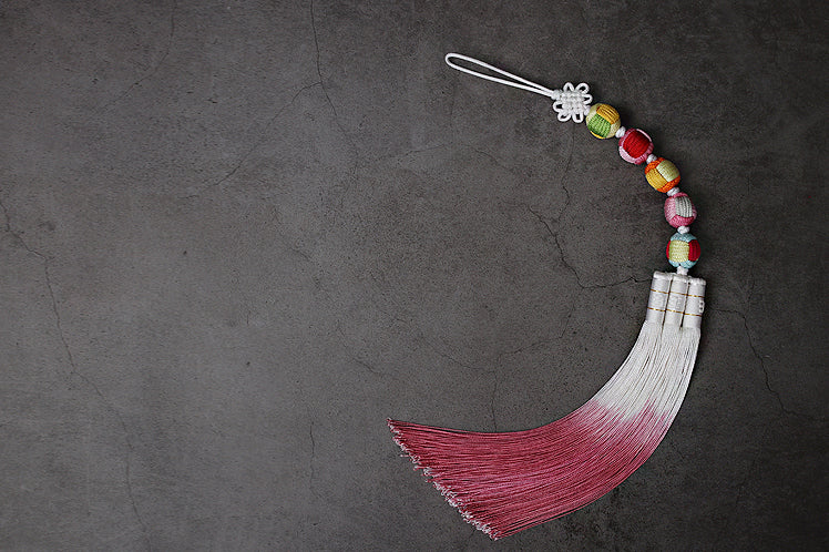 This special tassel features balls that represent the five elements and it's a very classy decoration.