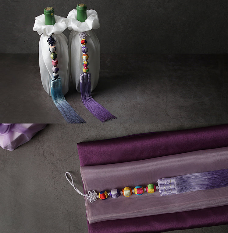 Creative and colorful are two ways you can describe the Five Elements Trio Tassel.