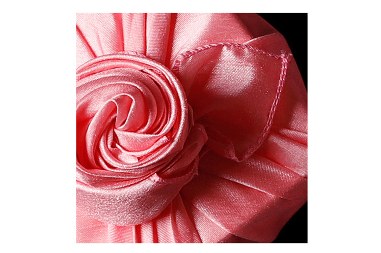 An intricate knot on the rose colored single sided Korean Bojagi adds flair and elegance to any gift or social event.