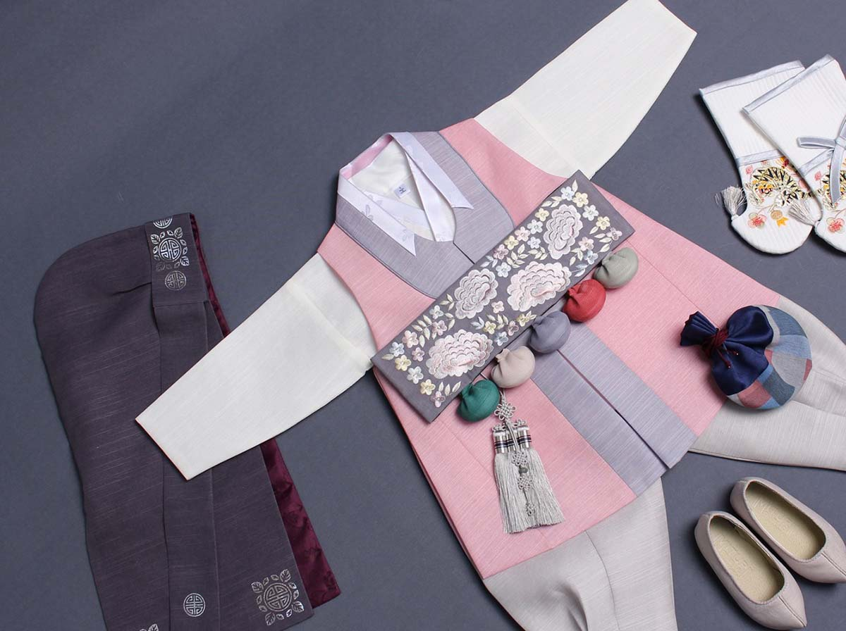 This image shows the stunning look of the Classy Prince Baby Boy Hanbok in roseate.