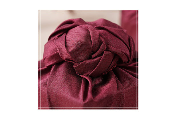 The ruby colored Bojagi Art is a classic and iconic color if you're looking for fabric wrapping cloth for boys or girls.