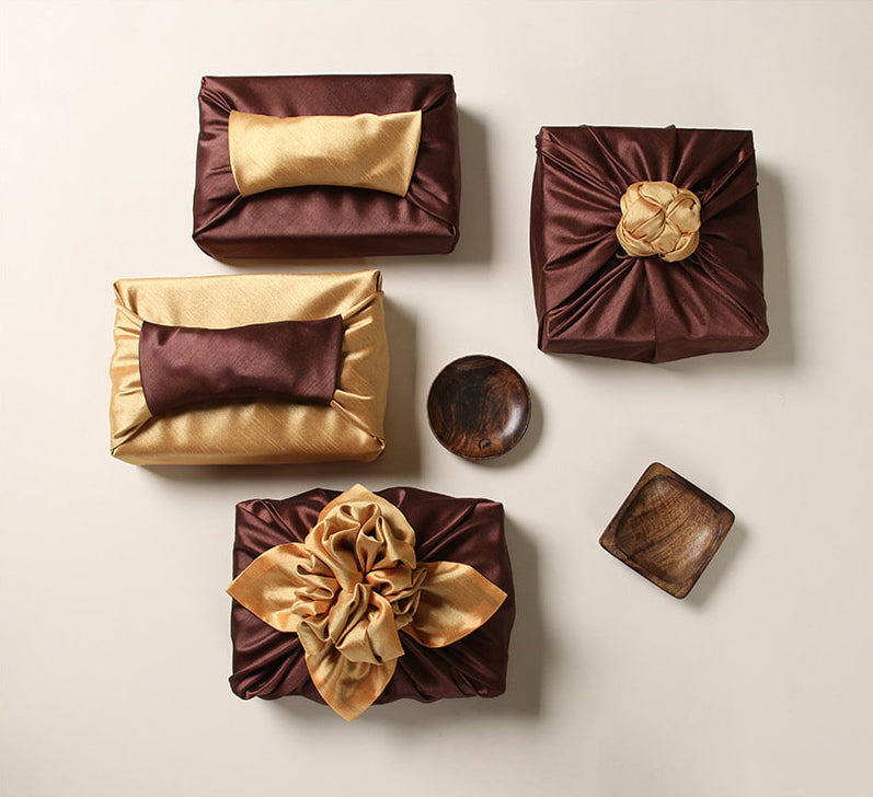 Wrapping presents with fabric brings a captivating look to any formal event.