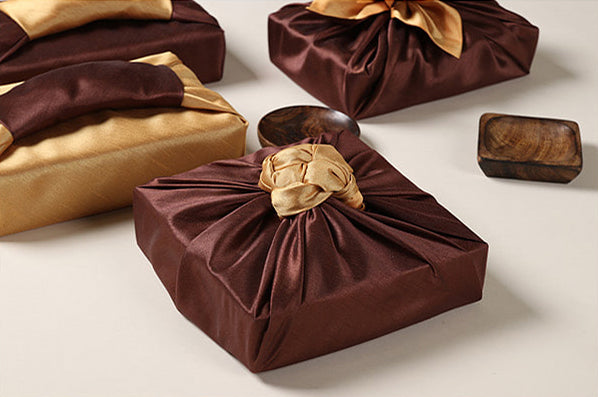 Camel and saddle colored Bojagi Korean wrapping cloth adds a tactful ending to any gift.