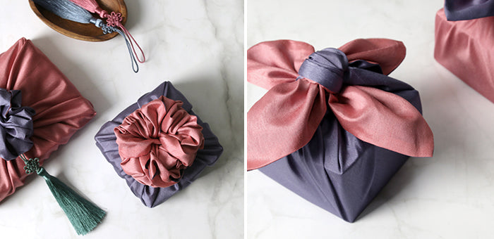 Wrapping presents with fabric, such as this periwinkle and rouge Korean Bojagi, injects charm.