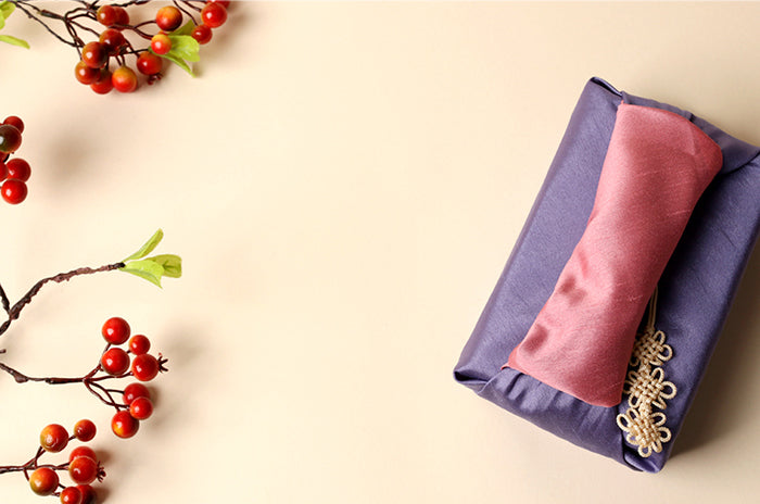 Whether it's Christmas or a Harvest Festival, this amethyst and salmon fabric wrapping paper is a sublime choice of Bojagi gift wrap.