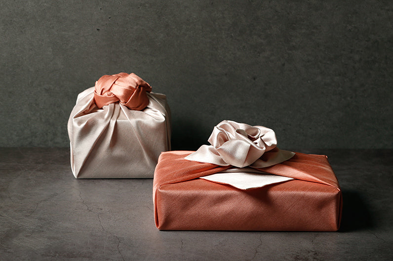 Beautiful bows at the point of the present make the titian and khaki Bojagi fabric wrapping paper a classic for any Korean formal or informal event.