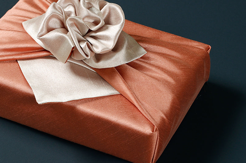 Tangerine and taupe double sided Korean fabric wrapping are stellar for any celebration or ceremony.