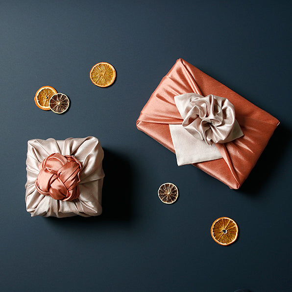 Add a colorful element to your gifts with this apricot and oatmeal fabric gift wrap.