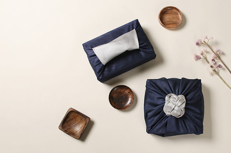 The top view of this azure and cream Korean wrapping cloth Bojagi shows you how easy wrapping presents with fabric is, even when the gift is odd-shaped.