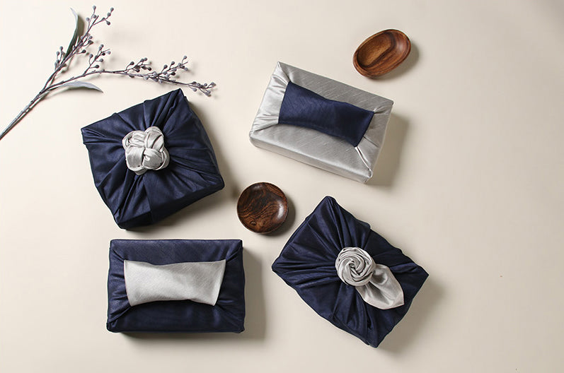 Decorate any formal or semi-formal celebration with the sapphire and achromic Korean Bojagi wrap.