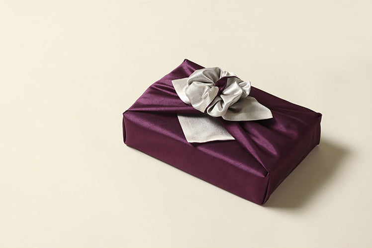 With the amethyst and pearl Bojagi Art, you'll turn heads the second you walk into the room with this fabric wrapping paper.