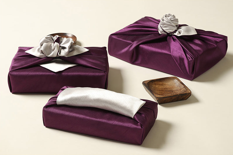 A side view of the pewter and periwinkle Bojagi gift wrap shows you how you can add flair to it with handles for an intricate finishing touch.