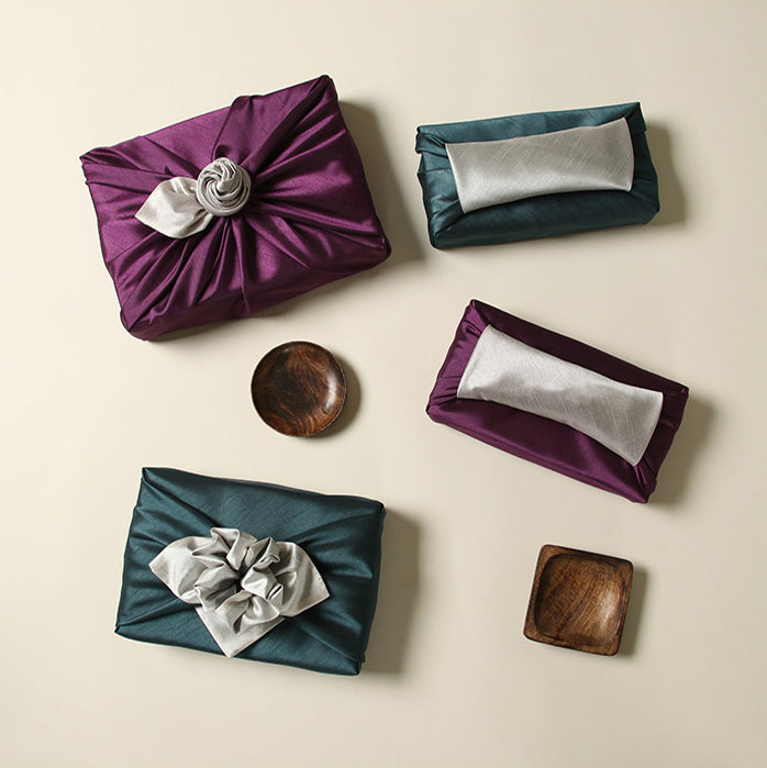Awkward sized or shaped objects can be wrapped without hassle using fabric wrapping, like in this orchid and off-white example.