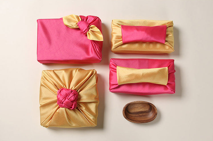 The coral and gold fabric gift wrapping adds an ornate look to any function and makes the present pop.