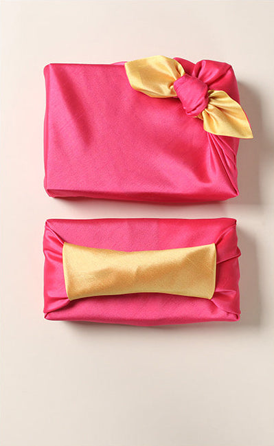 The fuchsia and tawny Korean fabric wrap adds a nice touch to any Christmas or birthday gift.