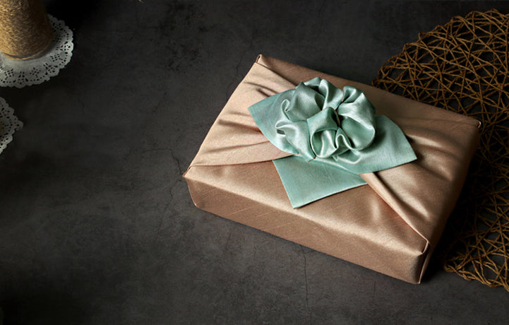 Forest and cream Bojagi art adds a traditional touch to any present where you want to use elegant fabric gift wrapping.