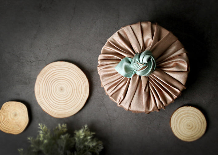 Jade and tan double sided Bojagi fabric wrapping paper brings a classic look to any Korean festivity.
